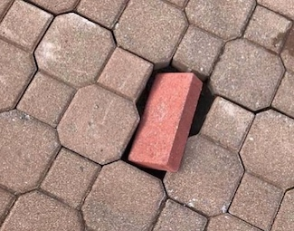 wrong brick in the road