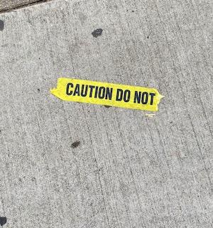 sidewalk caution tape found on the ground