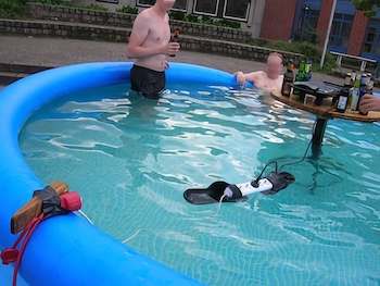 people in a pool with electronics