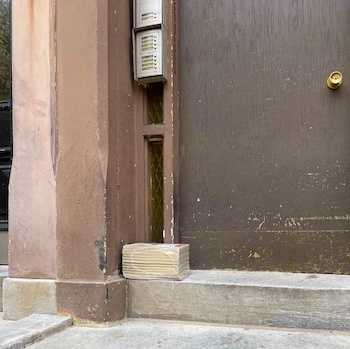 yellow page books sitting on doorsteps in the city
