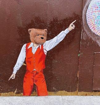 street art of a bear wearing a 3 piece suit