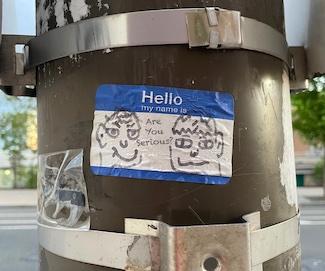 cartoon on street pole in Philadelphia