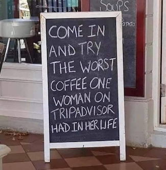 sign outside of a coffee shop