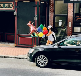 woman with balloons on street