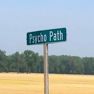 Psycho path sign on rural road