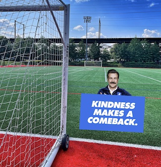 soccer field with ted lasso and kindness