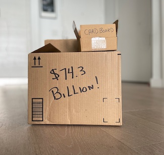 Cardboard boxes displaying the total annual revenue of the industry.