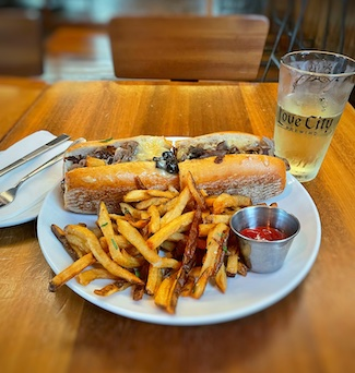 Philadelphia Cheesesteak with French fries and beer