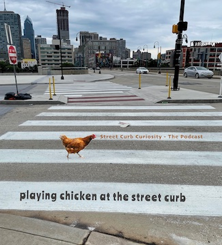 A chicken on the street in Philadelphia promoting the podcast Street Curb Curiosity
