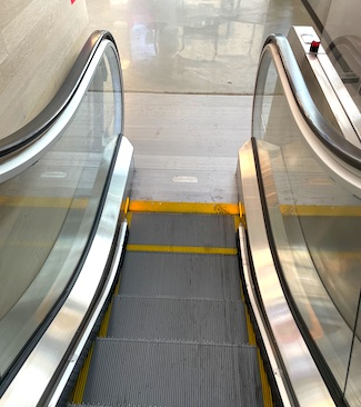 going down an escalator; about to get off