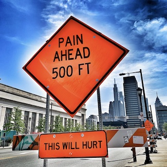 funny road construction sign about pain to promote a podcast