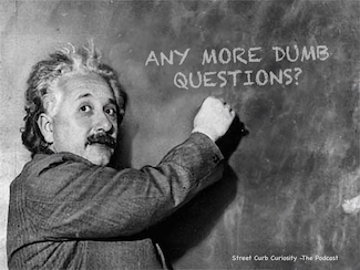 Albert Einstein at a black board promoting dumb questions on the podcast Street Curb Curiosity