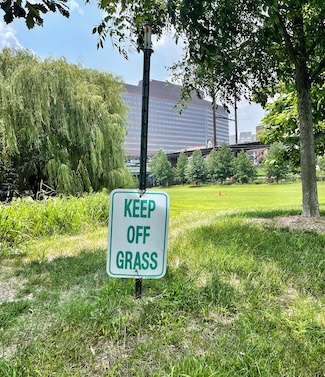 keep off grass sign too low to the ground