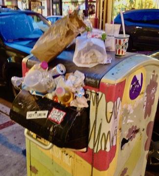 overflowing trash can on South Street, Philadelphia